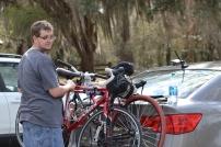 "J was the responsible one and put the bikes back on the car while I took pictures of the burn area. Notice his ""why are you taking my picture"" face? Yeah, I snuck one of him too!"